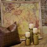 map & gold candle sticks