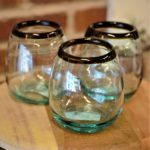 brown rimmed green stemless glass