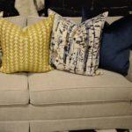 navy & gold pillows sofa